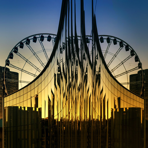 sunset evening goldenhour cityscape navypier centennialwheel ferriswheel shakespearetheater september summer chicagoillinois cityofchicago downtown cookcounty urban thewindycity chitown streeterville lakemichigan shoreline abstract squarecrop panels patterns skyline silhouette architecture mirrored geometric nikond7500 sigma18300 photoshopbyfehlfarben thanksbinexo wow