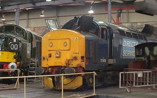 37409 at Barrow Hill, receiving attention, with 37057 behind, weeks before its release back onto the mainline. 04 04 2015