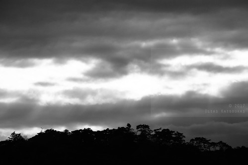 horizontal outdoors nopeople island fukuurajima pinecovered scenicview matsushimabay sky clouds cloudy weather lightthroughtheclouds rayoflight rayofsun sunlight silhouette blackandwhite monochrome bw travel travelling vacation canon 5dmkii camera photography december 2017 matsushima sendai miyagiprefecture tōhokuregion tohoku honsu asia japan
