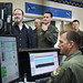 Remotely piloted aircraft qualification instructor pilots and student pilots review the training mission schedules of the the T-6 Flight Simulator at the 558th Flying Training Squadron at Joint Base San Antonio, Texas Jul. 17, 2018. Both officer and enlisted RPA student pilots spend 85 days in the RPA Instrument Qualification course (RIQ) and 30 days in the RPA Fundamentals Course (RFC) at the 558th FTS, during the second phase of the Air Education and Training Command's RPA pilot curriculum. Last names removed and obscured for OPSEC. (U.S. Air Force photo by Bennie J. Davis III)