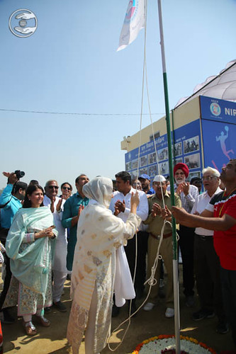 Satguru Mata Ji hoisting the flag