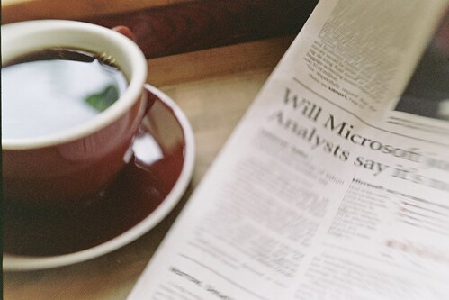 coffee and newspaper at grand central bakery | by cafemama