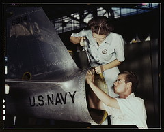 Mrs. Virginia Davis, a riveter in the assembly and repair department of the Naval air base, supervises Chas. Potter, a NYA trainee from Michigan, Corpus Christi, Texas. After eight weeks of training he will go into civil service. Should he be inducted or   by The Library of Congress