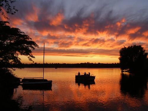 sunset reflection boat fisherman sail