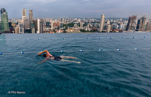Swimming atop the world class infinity pool Marina Bay Sands Hotel - Simgapore | by Phil Marion (176 million views - THANKS)