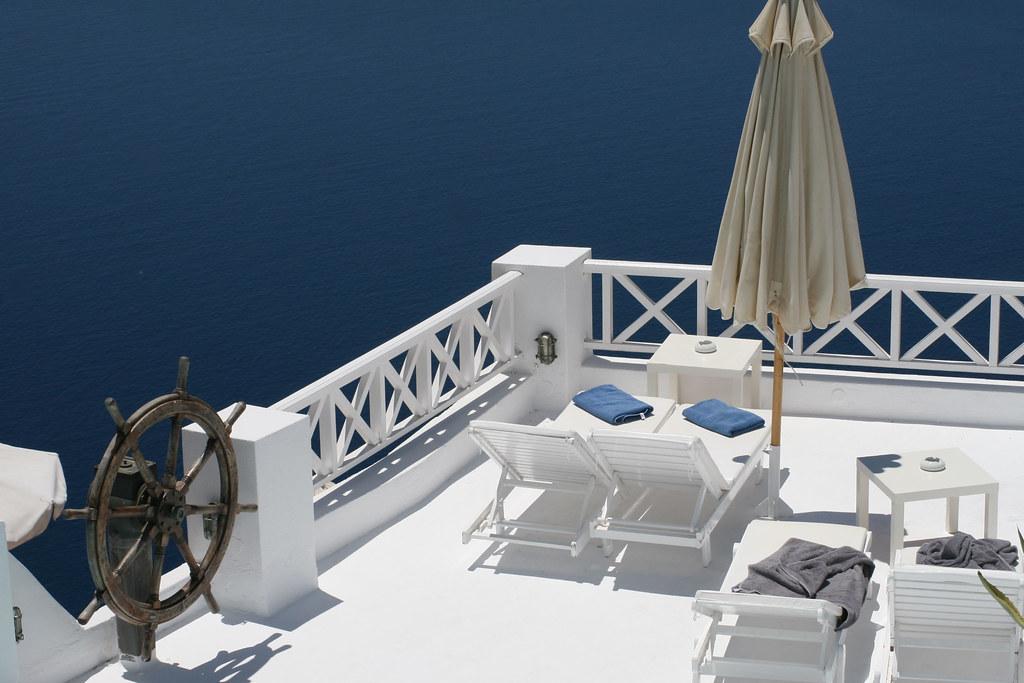A ships wheel in a hotel lounge area in Fira, Santorini