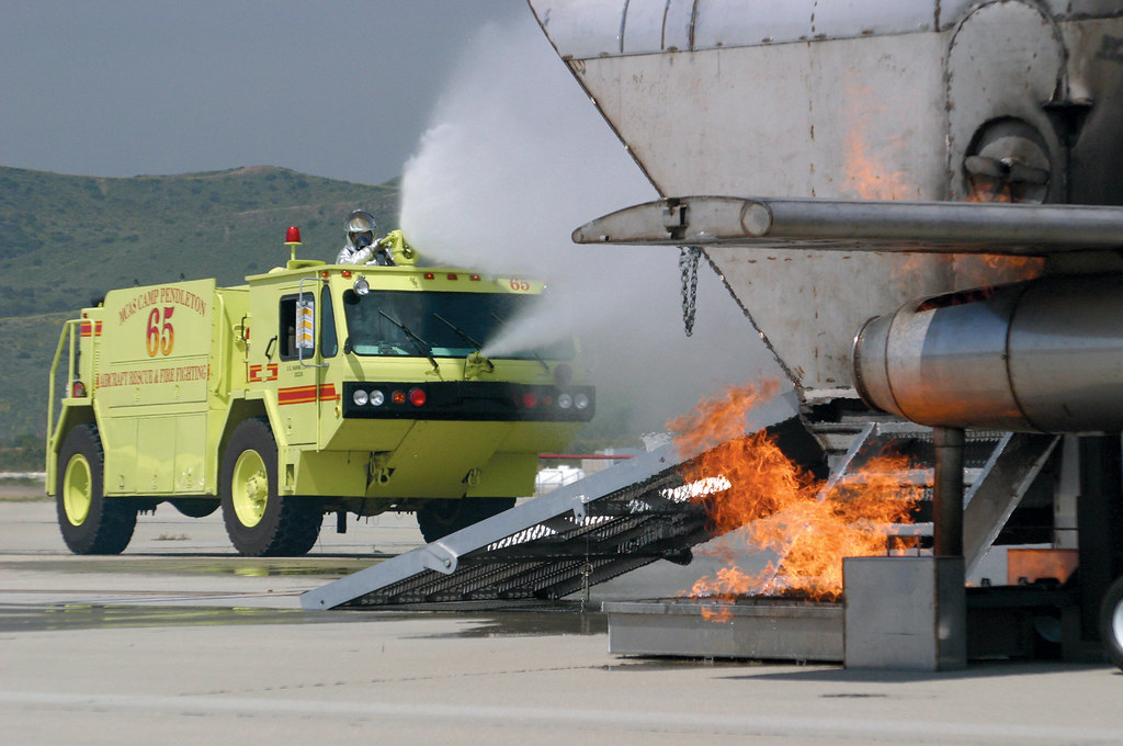 USMC Firefighter extinguish aircraft simulator fire | Flickr