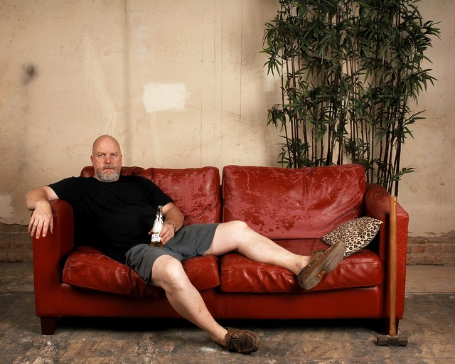 Portrait on a Red Sofa