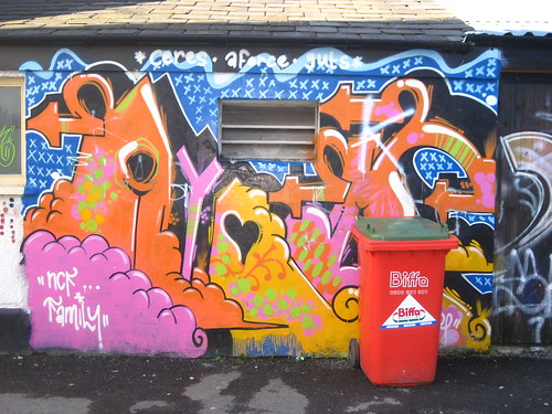 Graffiti and red bin