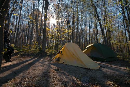 travel mi sunrise tents hiking michigan lifestyle editorial sunburst backpacker campsite ttk longshadows jordanriverpathway puremichigan