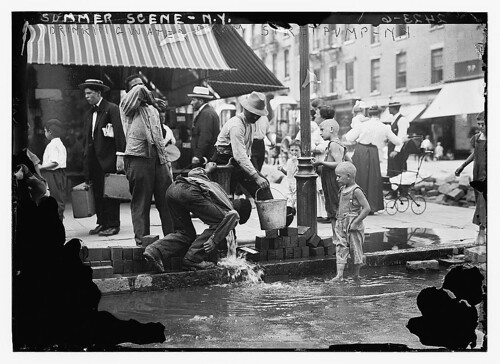 Summer scene, N.Y. - drinking water from street pump  (LOC)