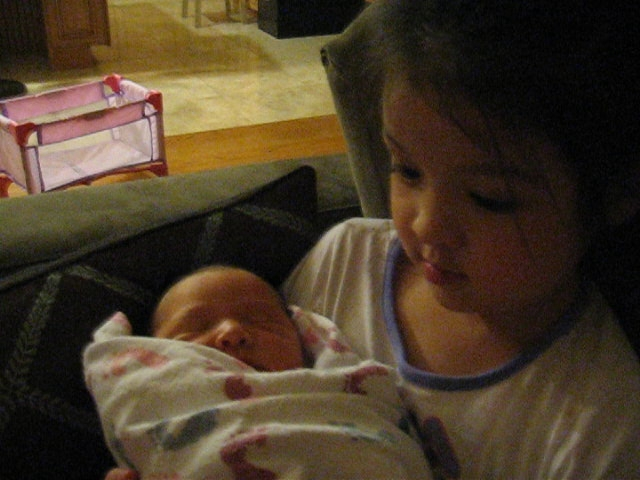 Anna's first time holding Joshua