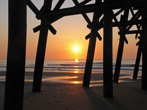 ocean morning travel sea sky orange sun black reflection beach wet water silhouette clouds sunrise canon geotagged myrtlebeach pier sand rocks waves south southcarolina online carolina myrtle sihouette beams 2007 s2 marchbreak 1on1sunrisesunsetsphotooftheday superbmasterpiece seasunclouds 1on1sunrisesunsetsphotoofthedayapril2007 naturewatcher hiybbpraqag geo:lat=3368389743470509 geo:lon=7888591237301637