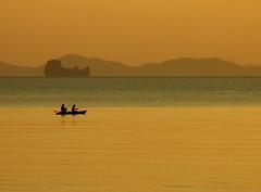 FIshing at Sunset off Tub Kaek Beach near Krabi, Thailand