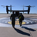 Chief Master Sergeant of the Air Force James Cody and a member of the flight crew walk out to a CV-22 Osprey aircraft before Cody's tandem parachute jump, his first, with members from the 26th Special Tactics Squadron May 6, 2015, Cannon Air Force Base, N.M.  Cody toured Cannon to experience the 27th Special Operations Wing mission, meet air commandos and discuss common concerns such as the enlisted promotion system, changes to Air Force retirements, and strategies for resiliency. (U.S. Air Force Photo/Master Sgt. Dennis J. Henry Jr.)
