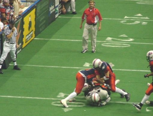 Carlos Smith and (I think) Mike Hanley squish Jay Bailey for a 2-yard loss.