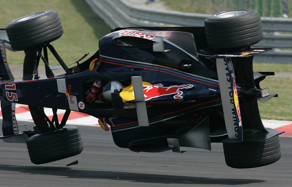 BUDAPEST, HUNGARY - JULY 31: Christian Klien of Austria and Red Bull rolls his car as he entered the first corner after being clipped by another driver during the Hungarian F1 Grand Prix at the Hungaroring on July 31, 2005 in Budapest, Hungary. (Photo by Mark Thompson/Getty Images)