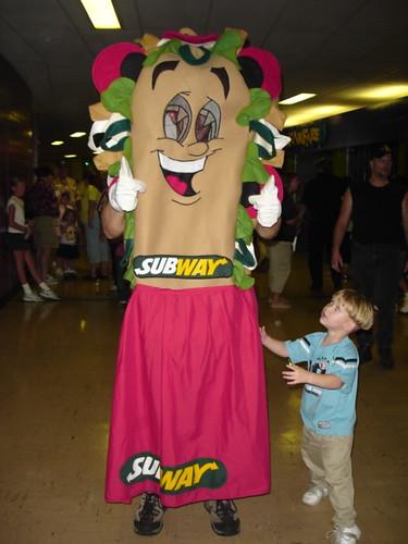 Kid hugging Subway Sandwich Man