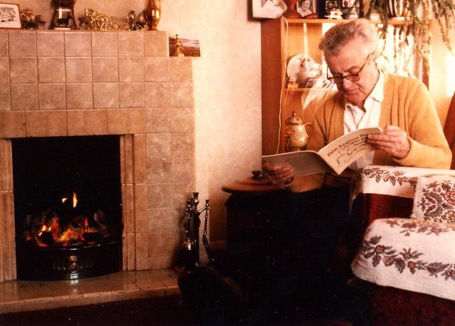 grandad reading recipe book