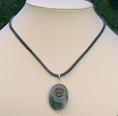 Quartz and rhodonite pendant on leather