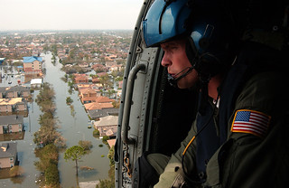 Keeping Watch: A Coastie keeps a sharp lookout from a helicopter over flooded New Orleans | by Tidewater Muse