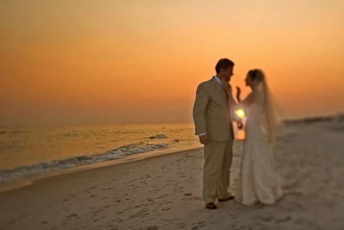ocean pink wedding sunset red portrait orange beach water beauty groom bride seaside sand waves gulf florida tiltshift