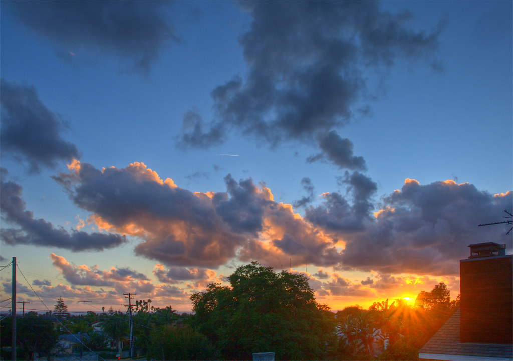 Sunset from our bedroom deck by Jim Frazee