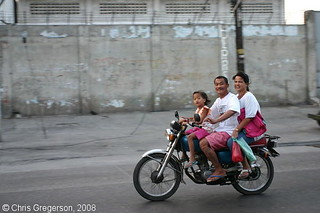 Family Speeding by on a Motorcycle, Angeles City | by Chris Gregerson