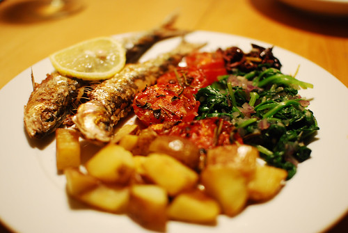 grilled sardines with wild sauteed spinach, grilled tomatoes, olives lemon zest and fried potatoes | by Paul Keller
