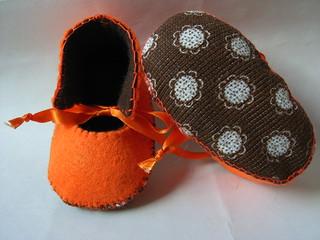 orange and chocolate handmade baby booties