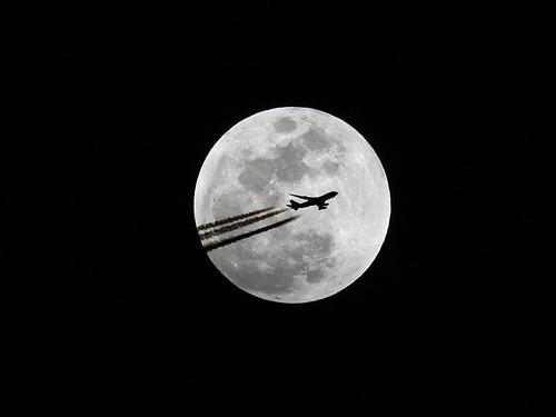 shadow moon silhouette airplane contrail full 747