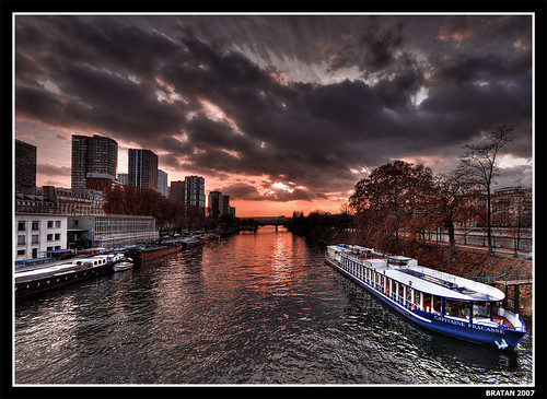 sunset sky paris france seine clouds river boat bravo searchthebest soe hdr builiding photomatix eow sigma1020 magicdonkey anawesomeshot flickrplatinum infinestyle goldenphotographer bratanesque ostrellina