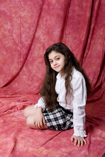 Aseel sitting on floor with knees folded | by paperbutterfly65