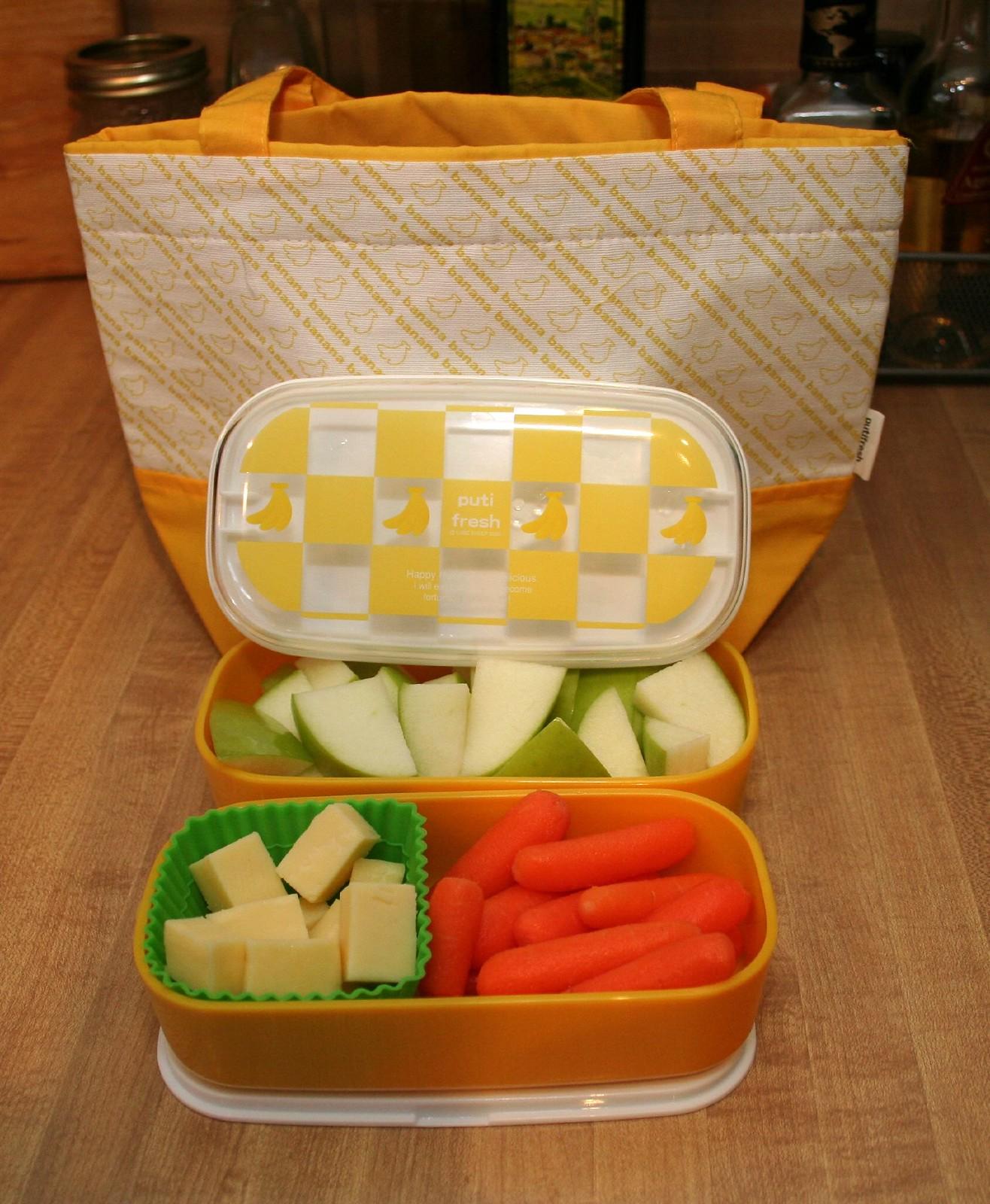 tupperware rempli de fruits et légumes