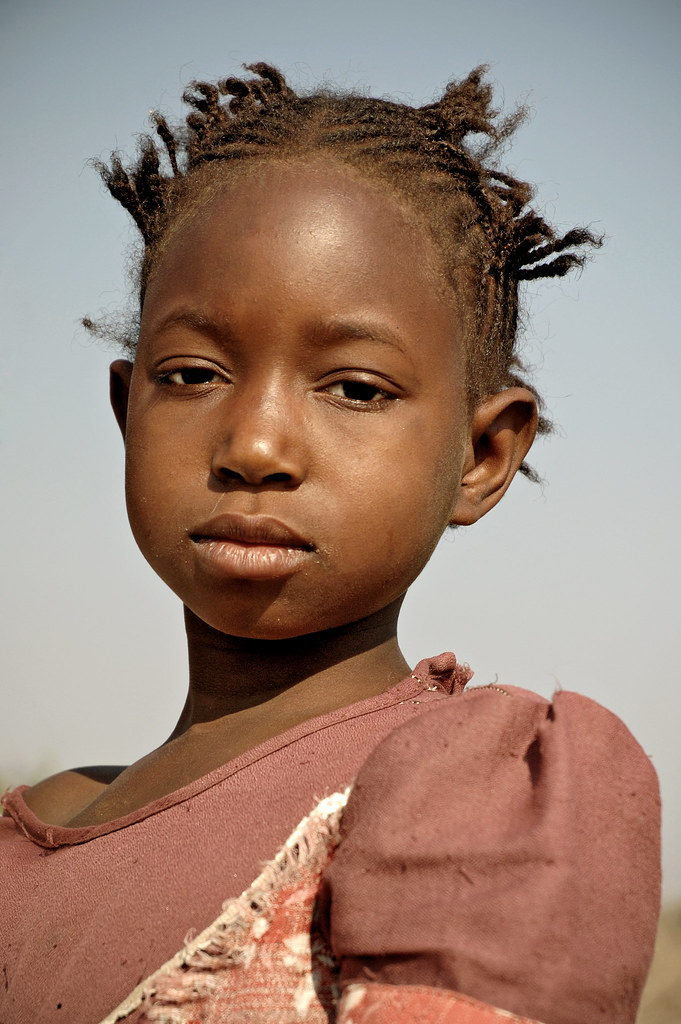 A lovely young Zambian girl with a traditional hair style