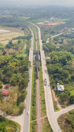 aerialphotography aerialview bridge city day dronephotography green color highangleview industry landscape nopeople outdoors railway track road traintracks transportation tree