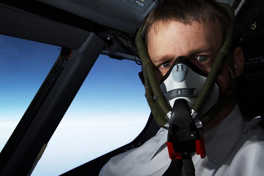 oxygen mask   pilot wearing oxygen mask   Lowell Sannes   Flickr
