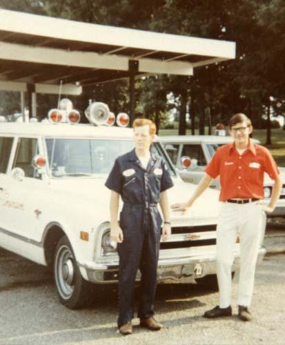 Jim Moshinskie, right, and Larry Russell, by Emerson & Son Funeral Home Chevrolet Suburban ambulances, Jonesboro, Arkansas, 1970, awaiting the next Code 3 run