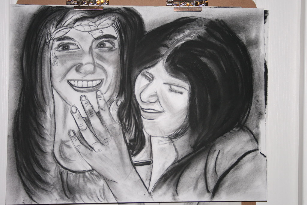 two faces charcoal drawing