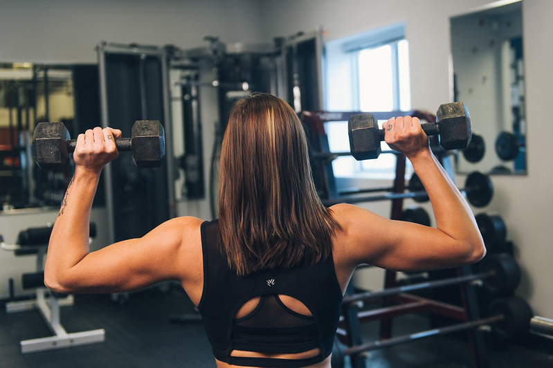 Fitness Model Shoulder Exercise Weight Training - Must link to https://thoroughlyreviewed.com