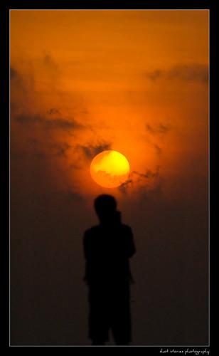 orange beach silhouette sunrise madras photographers 70300mm besantnagar varun shotstories