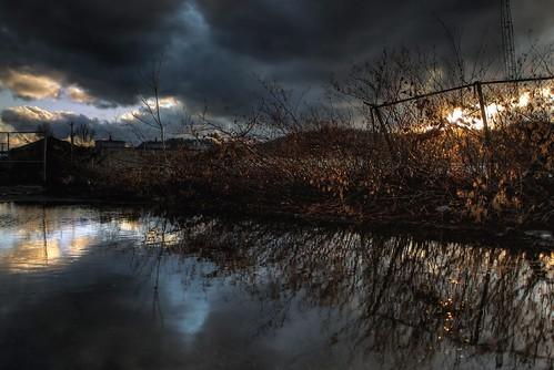 sunset sky reflection clouds fence d50 puddle windy beavercounty ambridge sigmaaf24mmf28macro