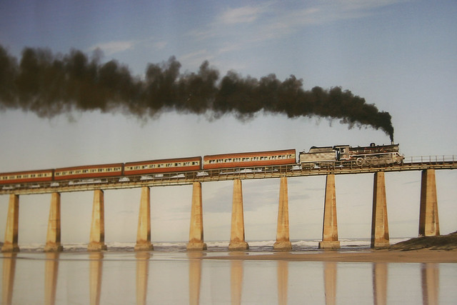 Outeniqua Choo-Tjoe ( South Africa) : Old romantic steamlocomotive on bridge along the Indian Ocean