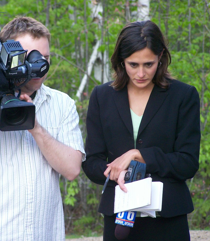 Reporter intently listens | Kria Sakakeeny, Anchor/Reporter
