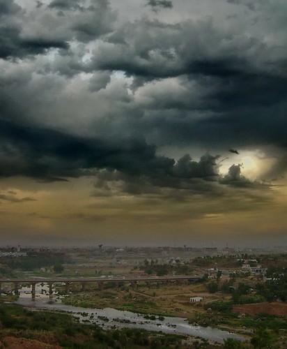 bridge pakistan storm rain clouds landscape swan scene