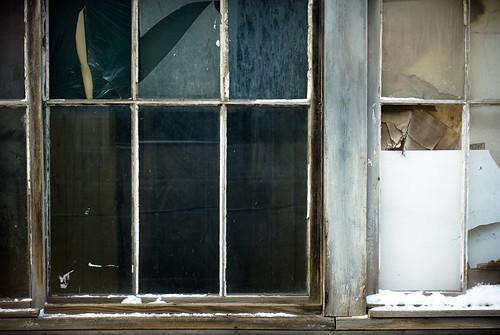 winter snow building abandoned broken window glass work nikon downtown december nb fredericton newbrunswick boarded rundown garbagebag throughawindow d80 seanmcgrath