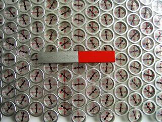 bar magnet on a compass array | by daynoir