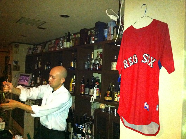 Tiger pulling a pint at Fenway Park in Kyoto