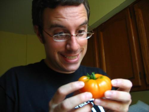 Chris Admires Freshly Picked Tomato