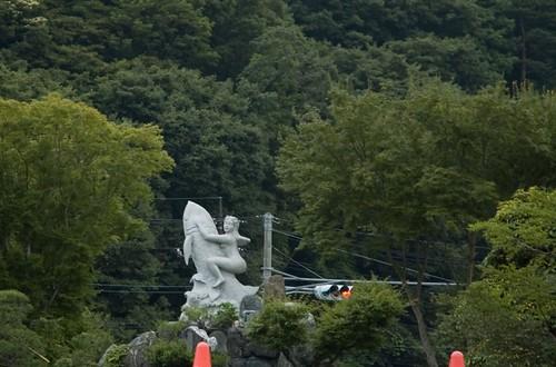 {7-11} statue
